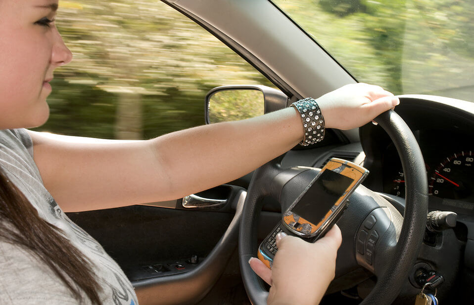 Image of a girl texting and driving